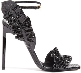 SAINT LAURENT Edie ruffle-trimmed snakeskin sandals $995 thestylecure.com