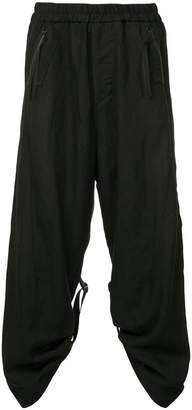 Julius loose-fit strap detail trousers