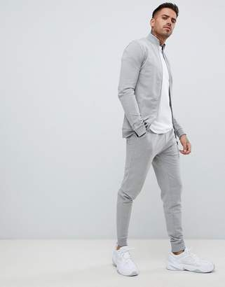 Asos DESIGN tracksuit muscle jersey track jacket/skinny joggers in gray marl