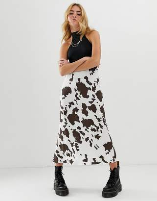 Asos Design DESIGN bias cut midi slip skirt in cow print