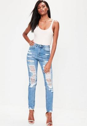 Blue High Rise Ripped Mom Jeans $67 thestylecure.com