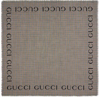 5a39336417e Gucci Check wool shawl with logo