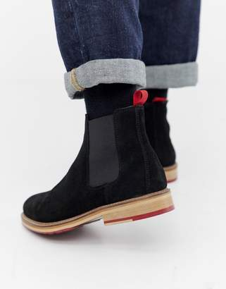 Asos Design DESIGN chelsea boots in black suede with red cleated sole