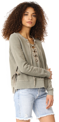 Pam & Gela Side Slit Lace Up Sweatshirt $165 thestylecure.com