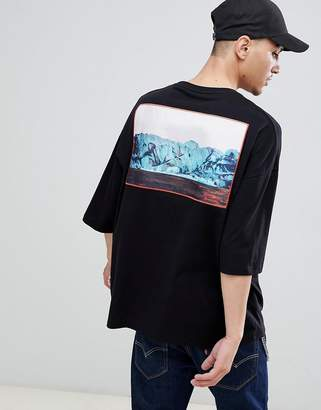 Asos DESIGN oversized t-shirt with woven sewn on abstract patch with half sleeve