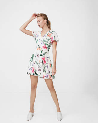 Express Floral Surplice Flutter Sleeve Fit And Flare Dress