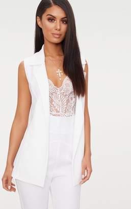 PrettyLittleThing White Sleeveless Belted Blazer