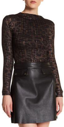 TOPSHOP Animal Print Ribbed Turtleneck $68 thestylecure.com