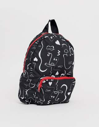 Asos Design DESIGN fold away backpack in abstract face print