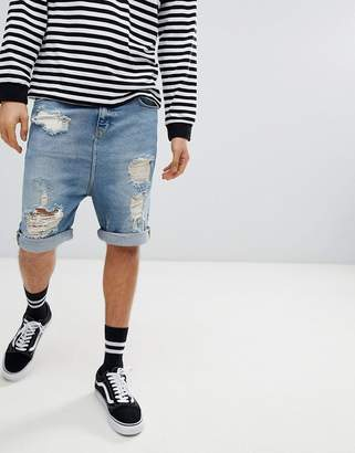 Asos DESIGN Drop Crotch Denim Shorts With Extreme Rips In Vintage Blue Wash