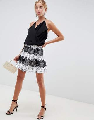 Asos DESIGN polka dot mini skirt with lace inserts