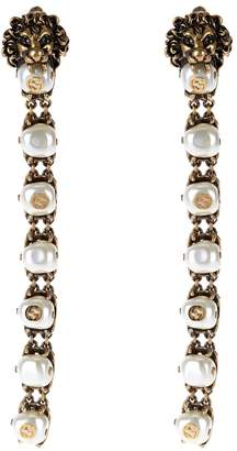 GUCCI Pearl-effect embellished lion earrings $1,750 thestylecure.com