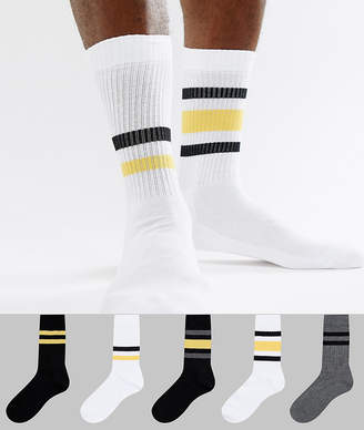 Asos DESIGN sports style socks in monochrome with yellow stripes 5 pack