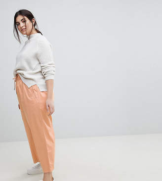 Asos DESIGN Curve soft wide leg pants in dusty pink