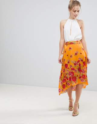 Asos DESIGN satin wrap midi skirt in floral print