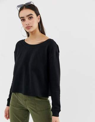 Asos Design DESIGN off shoulder boxy sweatshirt with split back in black