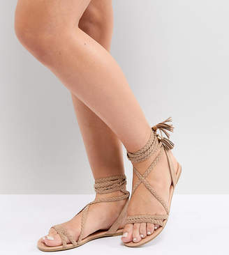 74d40aac574 Asos Design DESIGN Fayla Wide Fit Tie Leg Plaited Flat Sandals