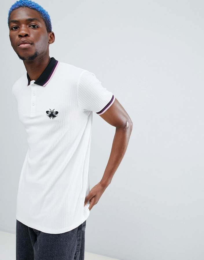 ASOS DESIGN polo in rib with wasp chest embroidery and tipped collar