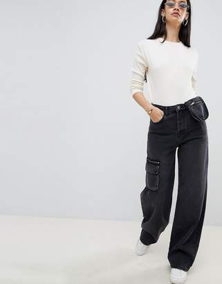 Asos DESIGN utility skater jeans with fanny pack detail in washed black