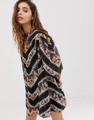 Asos Design DESIGN collar mini swing dress in 70s paisley stripe