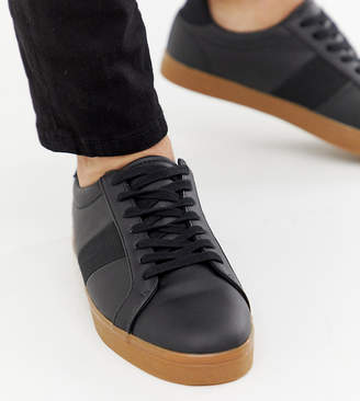 Asos Design DESIGN Wide Fit sneakers in black with gum sole