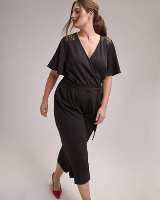 Solid Jumpsuit with Sash and Lace Detail - In Every Story