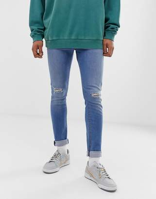 086e7621e6f Asos Design DESIGN super skinny jeans in light wash with knee rips
