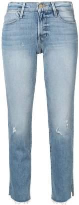 Frame Le High raw edge slit rivet jeans