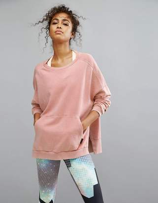 Reebok Studio Oversized Sweatshirt In Pale Pink $72 thestylecure.com