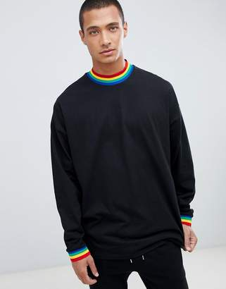 Asos DESIGN oversized longline long sleeve t-shirt with rainbow neck and cuff in black