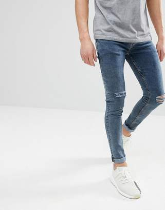 Asos Design DESIGN super skinny jeans in smokey overdyed blue with knee rips