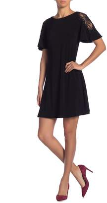 Gabby Skye Crochet Sleeve A-Line Dress