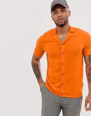 Asos Design DESIGN knitted button through revere polo in orange