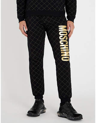 Moschino Metallic logo-appliqué quilted skinny cotton-jersey jogging bottoms