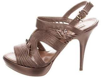 Alaia Metallic Platform Sandals