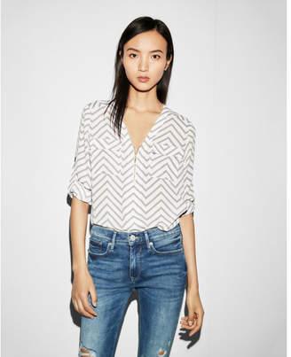 Express chevron long sleeve zip front blouse
