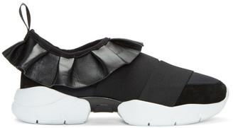 Emilio Pucci Black Ruffle Slip-On Sneakers $525 thestylecure.com