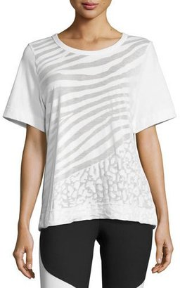 adidas by Stella McCartney Climalite Animal-Print Workout T-Shirt, White $75 thestylecure.com