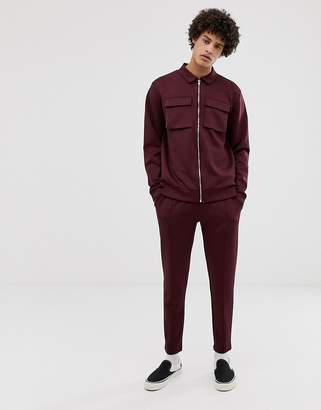 Asos Design DESIGN poly tricot tracksuit harrington jacket/skinny sweatpants with chest pockets in burgundy