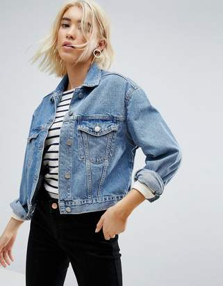 Asos DESIGN denim jacket in midwash blue