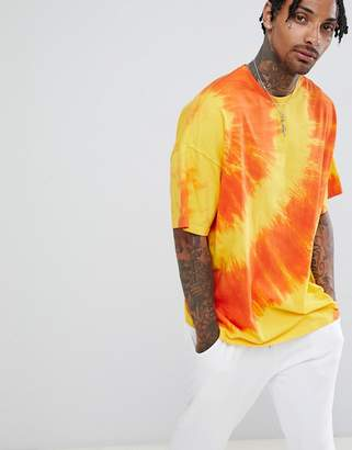 Asos DESIGN oversized longline t-shirt with diagonal tie dye in yellow