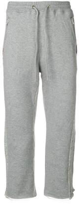 Facetasm cropped logo track pants