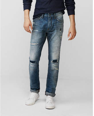 Express slim medium wash destroyed 100% cotton jeans