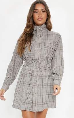 PrettyLittleThing Chocolate Check Print Popper Front Drawstring Waist Shirt Dress