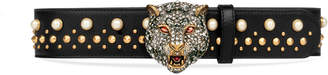 Studded belt with crystal feline head $1,700 thestylecure.com