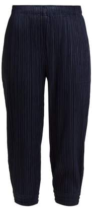 Pleats Please Issey Miyake Pleated High Rise Tapered Trousers - Womens - Navy