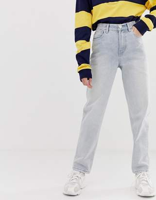 Asos Design DESIGN relaxed leg boyfriend jeans in bleached blue wash with bum rip detail
