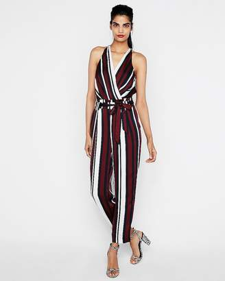 e18b0220c4e4 at Express · Express Petite Striped Belted Surplice Jumpsuit