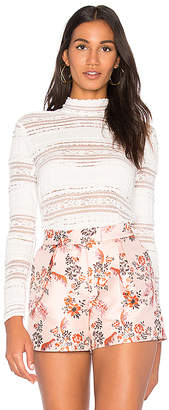 Endless Rose Mock Neck Textured Lace Top in White $81 thestylecure.com