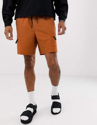 Asos Design DESIGN cargo shorts with utility pockets in orange